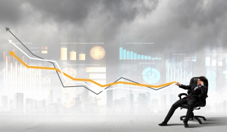 Image of young businessman pulling graph  Chart growth concept