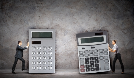 Image of two businesspeople with big calculators