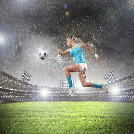Image of young woman football player hitting ball