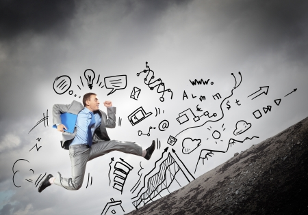 Image of jumping young businessman
