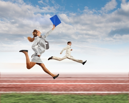 Image of business people running on tracks  Competition concept