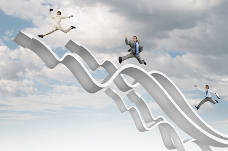 Young businesspeople jumping on white arrows  Growth concept