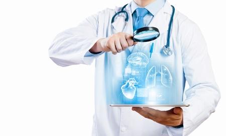 Foto de Close-up of doctor s body with tablet pc in hands - Imagen libre de derechos