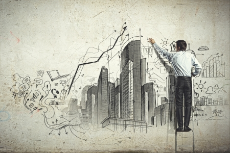Foto de Back view of businessman drawing sketch on wall - Imagen libre de derechos