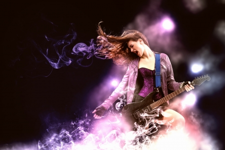Photo pour Young attractive rock girl playing the electric guitar - image libre de droit