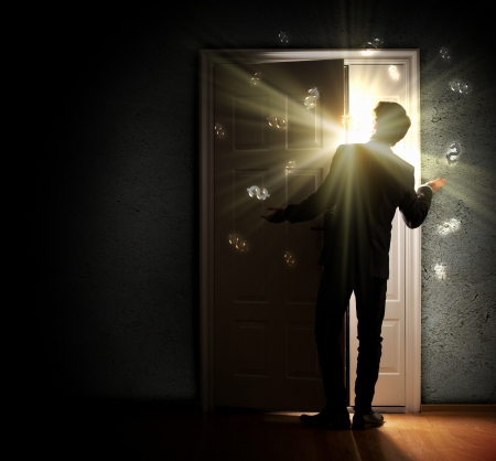 Image of young businessman standing with back opening door against dollar sigh background