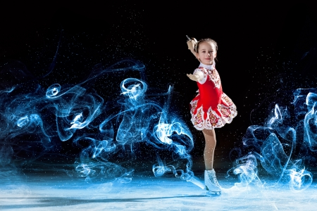 Little girl figure skating at sports arena