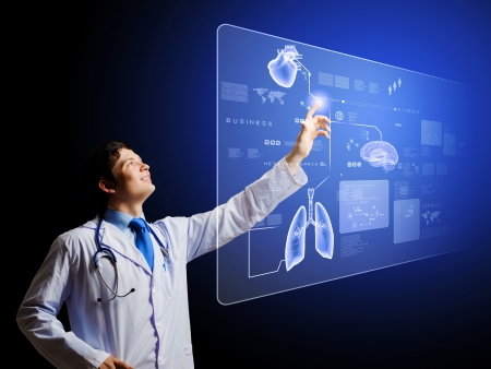 Young male doctor touching icon on media screen
