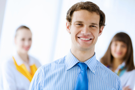 Image of successful young happy business persons