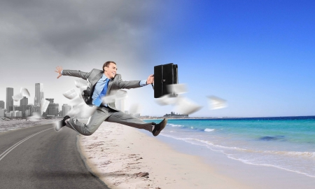 Image of businessman running away from office work