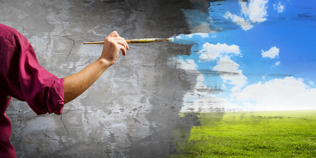 Photo pour Young handsome man painter with brush in hand - image libre de droit
