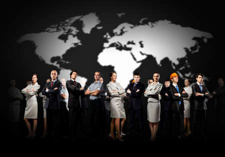 Group of businesspeople standing together against a world map background