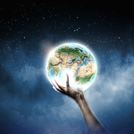 Close up of human hand holding Earth planet