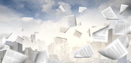Foto de background image with papers flying in air - Imagen libre de derechos