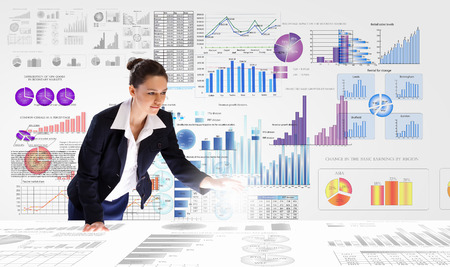 Photo for Young businesswoman analyzing data information of market - Royalty Free Image