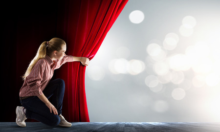 Photo pour Young woman in casual opening red curtain - image libre de droit