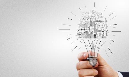 Photo pour Close up of businessman hand drawing business strategy sketches - image libre de droit