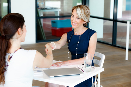 Photo pour Business woman shaking hands with someone - image libre de droit