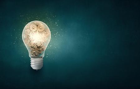 Photo pour Conceptual image with light bulb and gears inside - image libre de droit