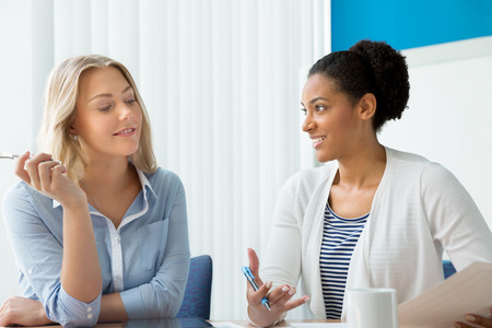 Photo pour Two women working together in office - image libre de droit