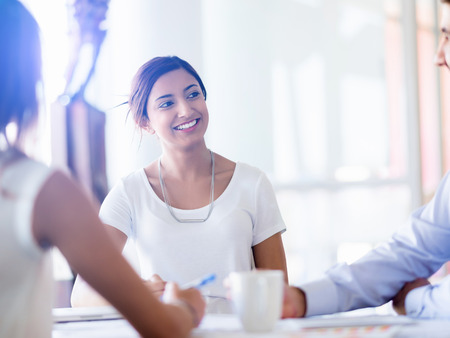 Foto per Team having a discussion in office - Immagine Royalty Free