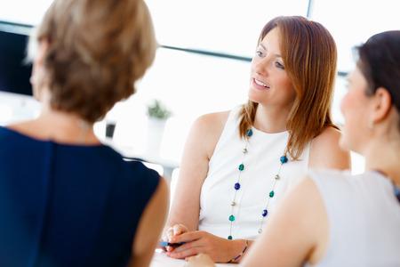 Attractive businesswoman talk in office