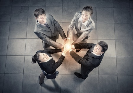 Photo for Top view of business people with hands in stack - Royalty Free Image