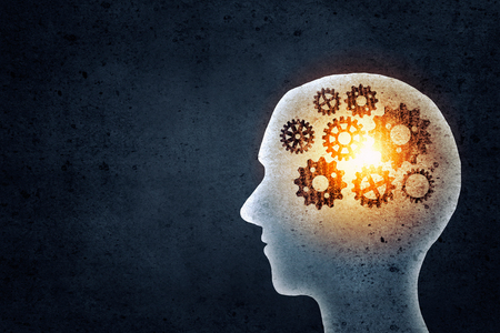 Photo for Silhouette of human head with gears mechanism instead of brain - Royalty Free Image