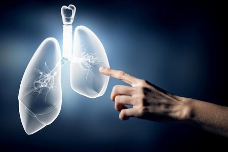 Photo pour Close up of hand touching lungs sign - image libre de droit