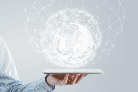 Photo pour Businessman holding in hand tablet with global connection concept - image libre de droit