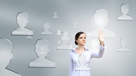 Photo for Businesswoman pressing modern social icons on virtual screen - Royalty Free Image