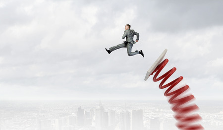 Photo for Businessman jumping on springboard as progress concept - Royalty Free Image
