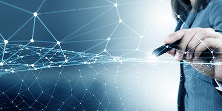 Photo pour Businesswoman hand drawing digital connection lines on virtual screen - image libre de droit