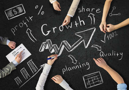 Top view of people hands drawing business strategy successful plan