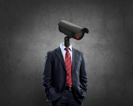 Foto de Portrait of camera headed man in suit as security concept - Imagen libre de derechos