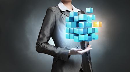 Photo pour Close view of businesswoman shows cube as symbol of modern technology - image libre de droit