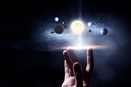 Foto für Male hand touching with finger image of sun system planets - Lizenzfreies Bild