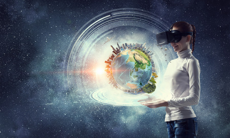 Photo pour Woman in helmet experiencing virtual reality. Mixed media. Elements of this image are furnished by NASA - image libre de droit