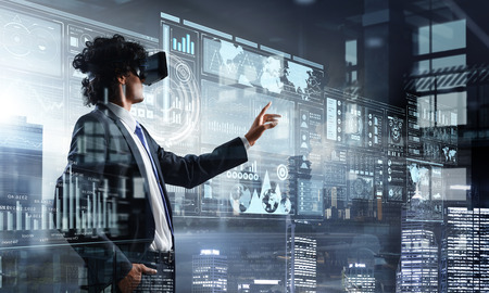 Photo pour Experiencing virtual reality. Mixed media - image libre de droit