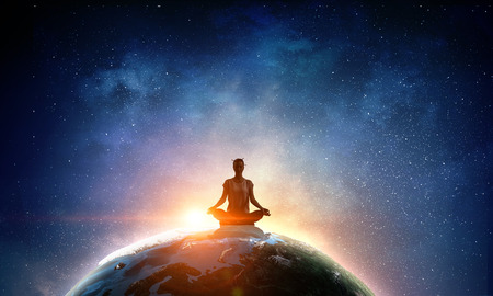 Photo for Young woman sitting on Earth planet and meditating. - Royalty Free Image