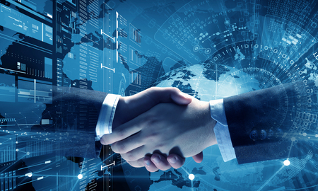 Photo pour Business handshake as symbol for partnership - image libre de droit