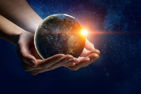 Male hands holding earth planet.