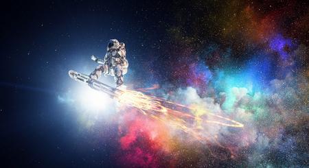 Foto de Astronaut flying on futuristic rocket skateboard in outer space. Mixed media - Imagen libre de derechos