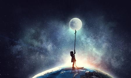 Photo pour Kid girl catching moon - image libre de droit