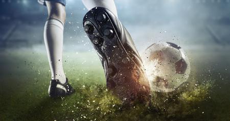 Photo for Foot of soccer player kicking ball. Mixed media - Royalty Free Image