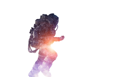 Double exposure of astronaut and space on white background. Mixed media
