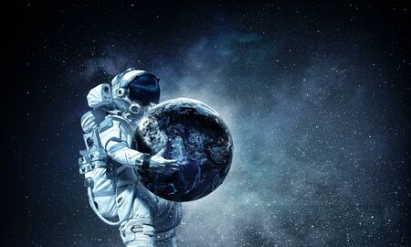 Photo for Astronaut carrying Earth planet in hands. - Royalty Free Image