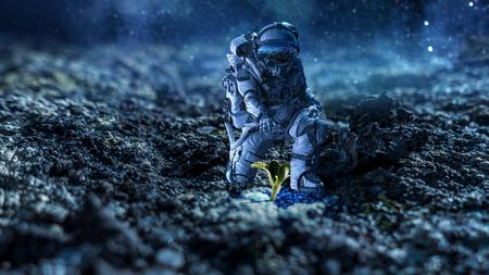 Foto de Astronaut in space suit reaching hand to touch sprout. Mixed media - Imagen libre de derechos