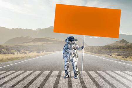 Photo pour Spaceman with banner. Mixed media - image libre de droit