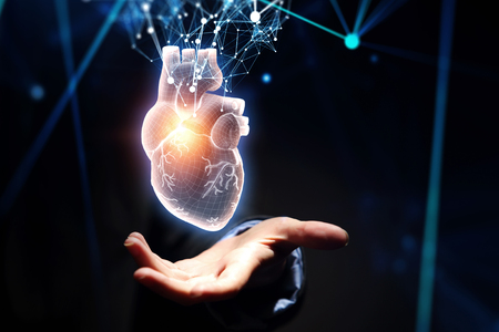 Photo pour Woman s hand showing digital anatomical heart model. Mixed media. - image libre de droit